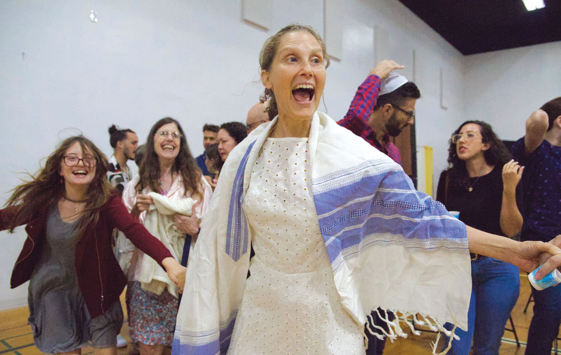 Rabbi Susan Goldberg dancing with the community