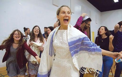 Rabbi Susan Goldberg dancing with the community